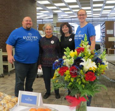 Electric Cookie Jar owners Joe and Amanda Moore with Friends volunteers Maureen Versaci and Patti Rotunda