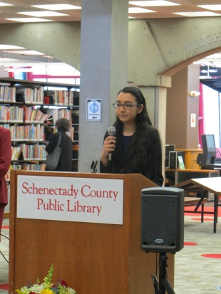 Junior Friend Shaheen Hasan speaks to the crowd.
